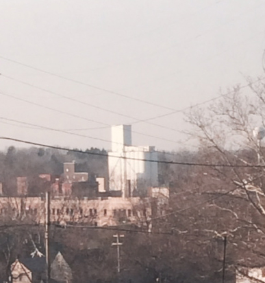 cropped distant silos